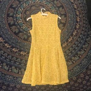 a yellow knee high dress